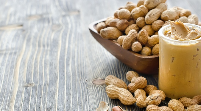 Peanuts next to peanut butter, common food allergen